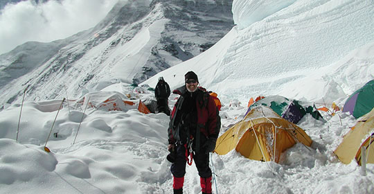 Dr. Semple in 2005 on the North Col with tents burried in snow (Photo: Dr. John Semple)
