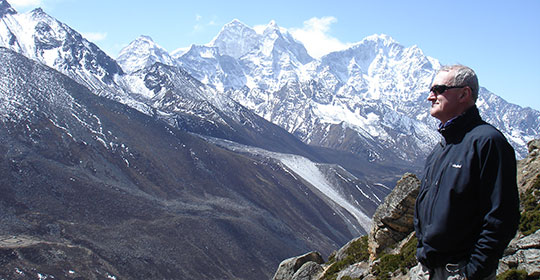 Dr. Semple in 2007 in Dingboche, a Sherpa village located in the Chukhung Valley, which is a popular stop for acclimatizing climbers. Mount Everest's North ridge can be seen in the background (Photo: Dr. John Semple)