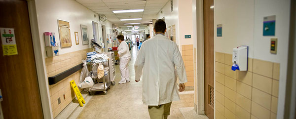 Doctor walking down a hospital hallway