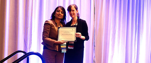 Dr. Sen receiving her award from the AAMC