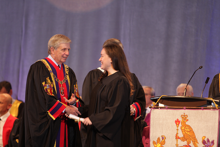 9.	Dr. Rorabeck congratulates a new Royal College Certificant at the 2014 Royal College Convocation ceremony.